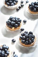 Blueberry tarts on marble
