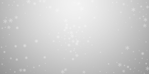 Sparse glowing snow Christmas background. Subtle f
