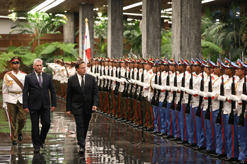 Cuban President Miguel Diaz-Canel and Panama's President Juan Carlos Varela review an honour guard during a ceremony at the Revolution Palace in Havana