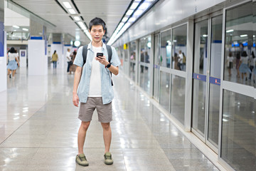 Portrait Asian man is traveler at subway for travel