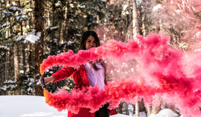 Attractive woman with a colorful smoke grenade