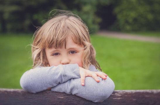 Portrait of a little sad  girl