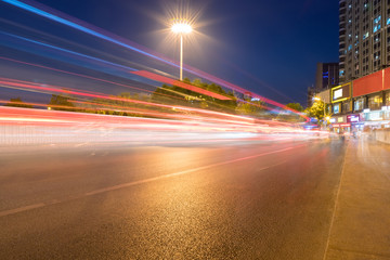 light trails on city street Fotomurales