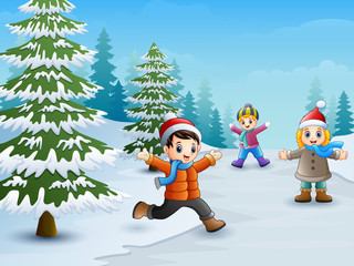 Happy kids playing in winter landscape