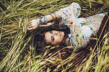 lying on grass in field