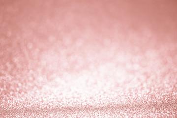 Rose gold glitter confetti background texture.