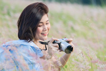 Outdoor summer lifestyle portrait of pretty young asian woman having fun
