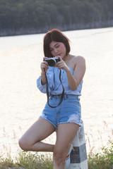 Young asian women taking photos outdoors