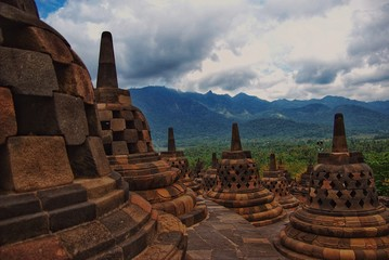 Fotobehang Indonesië Around the circular platforms are 72 openwork stupas, each containing a statue of the Buddha.