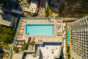 Aerial rooftop pool highrise city building