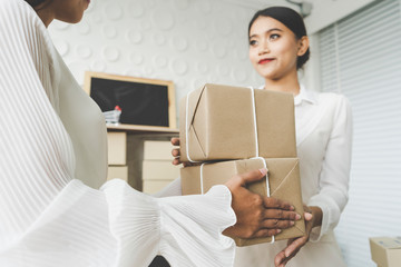 parcel delivery. Happy Asian woman accepting a delivery of boxes from delivery or in the warehouse. ,online market packing box delivery,Startup successful small business owner concept,Service Mind