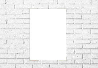 White paper sticked on white brick wall