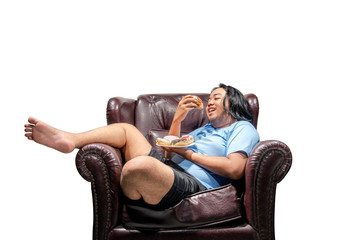 Happy asian fat man snacking donuts on plate in the couch