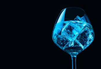 Glasses of wine with ice cubes