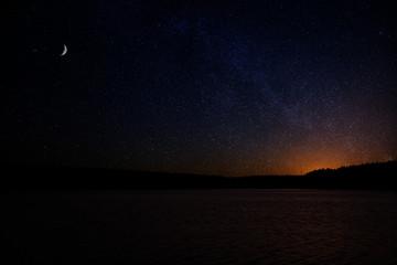 Dark night sky with the orange glow