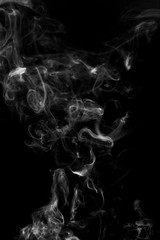 abstract white smoke in the air on a black background
