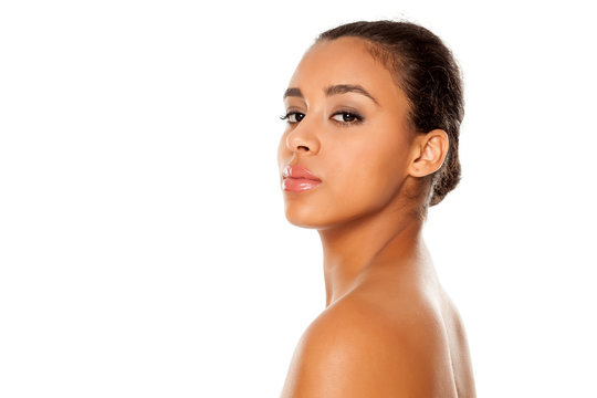 portrait of young beautiful dark-skinned woman with bun on a white background