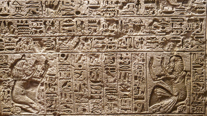CLOSE UP: Detailed view of beautiful Egyptian symbols carved into a stone wall.