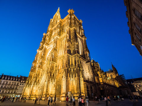 Strasbourg Cathedral illuminated at night (Cathedral of Our Lady of Strasbourg or Cathedrale Notre-Dame de Strasbourg), also known as Strasbourg Minster, Alsace, France wide angle