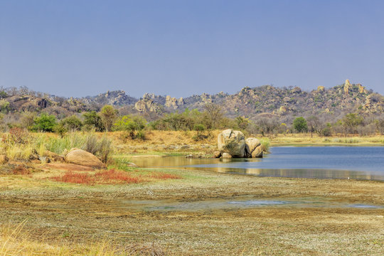 View of a lake surrounded by rocks, in Matobo National Park, Zimbabwe, Africa.