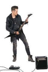Heavy metal guitarist performing and playing electric guitar.