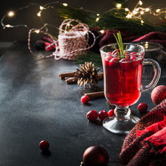 Christmas cranberry mulled wine garnish rosemary and fir branches on black. Xmas drink.