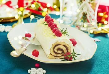 White chocolate cream yule log Christmas cake with  raspberries.
