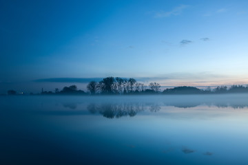 Fog on the lake after sunset