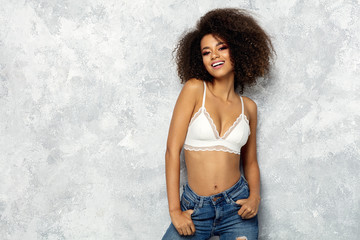 Wall Mural - Portrait of black woman with copy space wear white bra looking at camera and smiling