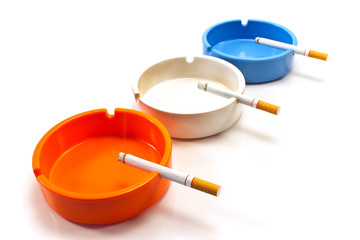 Cigarettes in ashtray isolated on white