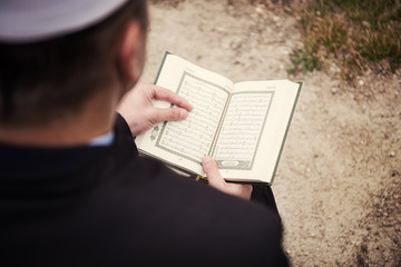 quran holy book reading by imam  on islamic funeral