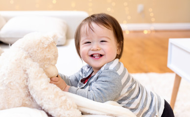Happy toddler boy smiling in his house