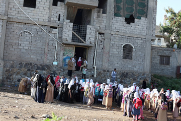 Students gather for a morning drills outside of the teacher's house, who turned it into a makeshift free school that hosts 700 students, in Taiz