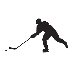 Ice hockey player passing puck, isolated vector silhouette, side view