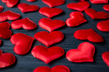 Red love hearts on a blue wooden background. Valentine's Day 2019. Background for greeting card.