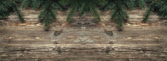 Old wood background with fir branches. Space for a greeting message. Christmas card. Top view.