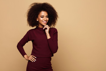 Wall Mural - Happy black woman with an afro hairstyle and copy space looking at camera