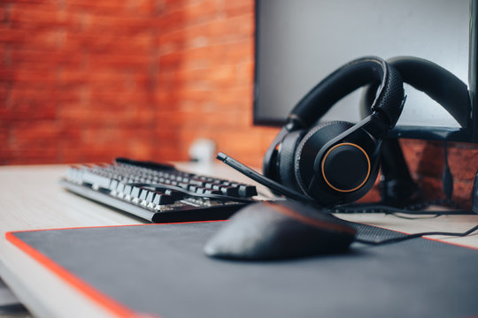 Gaming arena background with mouse gear headphones computer, focuse on headphones selected focuse