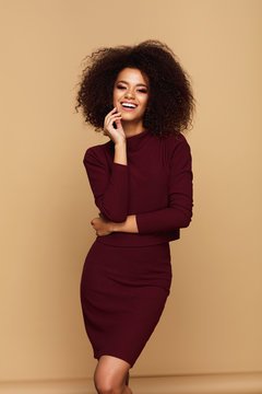 Beautiful african american woman with afro isolated on studio background with copy space
