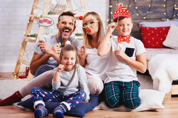 Portrait of happy family with christmas mask