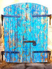 Rusty old blue mediterranean door