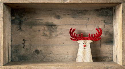 Christmas symbols decoration wooden reindeer in a wooden box