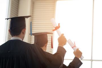 Graduates wear black hats on graduation day at the university.