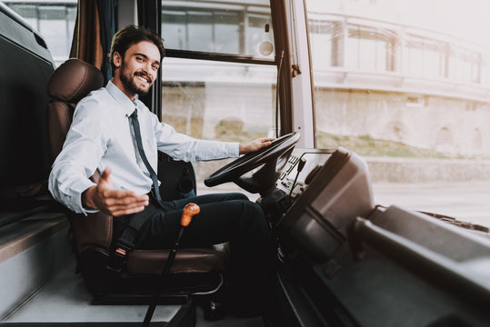 Smiling Man Driving Tour Bus. Professional Driver