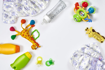 Set of accessories for baby. Pacifier, bottle, diaper, cream on white background.