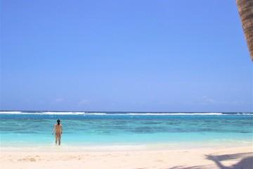 Woman at Beautiful beach in Maldives