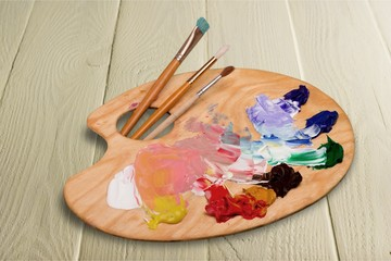 Wooden art palette with blobs of paint