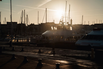 La Rochelle, France: 26 August 2018: Embankment at the La Rochelle city early in the morning at sunrise with lots of yachts and boats