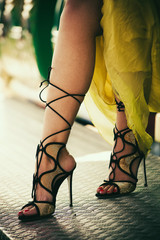 woman legs in elegant high heel sandals sit closeup summer