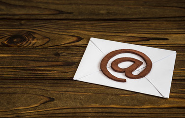 paper letter, email symbol on wooden background. Internet communication, interaction, information exchange.